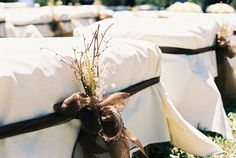 Casual seating for country  wedding - straw bales covered in calico and bound with a sash and dried grasses