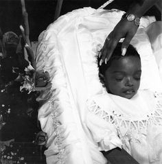 Previous Pinner: It's rare to see a coloured person in a post mortem photograph but a somewhat welcomed sight when one can be found. In this one, you can see a small child - possibly a boy - and possibly a parent's hand reaching out over him.