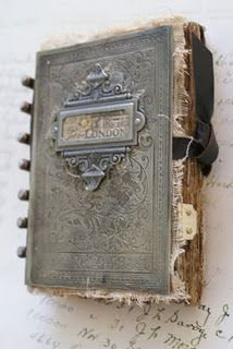 This could be a cool altered art project.  An old book mounted on a piece of wood on in a shadowbox frame, hung on the wall.  Within the book pictures and artwork.  Wall art that you flip through.