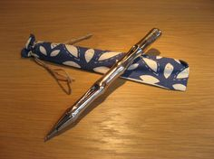 Silver bamboo shaped pen, comes in a fabric drawstring bag.  Excellent little gift - no wrapping required, or pop one in your own purse!  Available at Best of Friends Gift Shop in the lobby of Winnipeg's Millennium Library. 204-947-0110 info@friendswpl.ca Little Gifts, Gifts For Friends, Wrapping, Bamboo, Purses, Pop, Fabric, Silver, Handbags