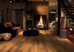 Quick-Step Hardwood Flooring - Castello wood 'Honey oak oiled' (CAS1472) in a country living room. To find more living room inspiration, visit our website: https://www.quick-step.co.uk/en-gb/room-types/choose-the-perfect-living-room-flooring #salon #woonkamer