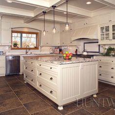 Kitchen Cabinets - love the beadboard!