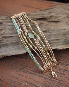 This multi strand design features beaded accents with Crystals and plated metal beaded. - Mix includes: Crystal, Plated metal beaded, Japan seed beaded