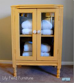 Arles painted open cabinet with blue towels. Gorgeous!