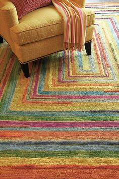 Our Concentric Squares Rug in Multi showcases fun, vibrant colors, just like the ones commonly found in a crayon box.