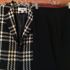 💕 Le Suit 2 Piece Suit 🌟2 Piece suit that's classy and long- (34 inches from shoulder to bottom of jacket), 18 inches across; black and cream plaid blazer has 3 hook and eye enclosures down the front, but also looks fabulous open! The pants are fully lined and a crepe material and have an inseam of 30 inches. 💕I'd keep it if I still wore this size! Excellent preloved condition, I'm accepting all reasonable offers!!! 🎉💃🏻🎉💃🏻 Le Suit Other