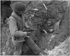 This German reservists isn't going anywhere even he wanted to. He's been buried in his own trench near Linnich, Germany, February 1945.