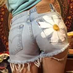 """ONE DAY SALE Daisy Levi cut off shorts Tag says size 5 but I would say theyre 13.5"""" across laying flat. So cute! Reworked by me  run small Levi's Shorts Jean Shorts"""
