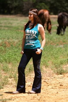 Dark wash wide legged jeans with a dream catcher from Fallon Taylor's Ranch Dressn line
