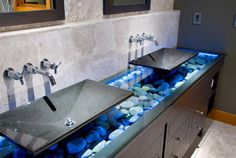 Blues and greys mixed with dark wood coverts can create a more contemporary look to your bathroom.