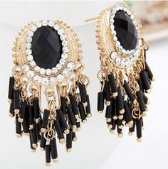 This beautiful black and gold bead earrings with rhinestones is a statement piece.The chandelier style earring just say GLAM all the way.