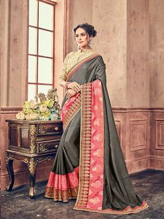 Gray & Pink Georgette Heavy Designer Embroidery work Saree, Grey georgette saree crafted with Pink jacquard with zari embroidered lase patch border. Saree with cream color jacquard blouse material. Blouse can be stitch as per style, subject to fabric limitation. The maximum blouse can be stitch up to 42-43 inches.