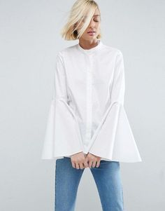 The Crisp Button-UpIt's the foundation of many a wardrobe — and lots of us have more than one in our closets. An interesting twist, like layers, adds something special to the classic piece.ASOS White Shirt With Bell Sleeve, $68, available at ASOS.  #refinery29 http://www.refinery29.com/classic-style#slide-30