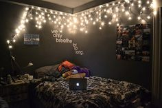 This is so similar to my room! Near the same color of paint, similar bedspread, except it's more purple than red. I love how the lights look against the dark gray!