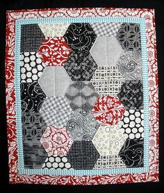 Half hex for Melissa's future kids red, black, and white play quilt?  @Melissa Brown Stiver.   Love the sashing of blue and white!