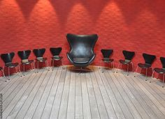 This photograph demonstrates ranking because the biggest chair is in the middle and all other smaller chairs are placed around them.