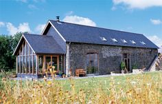 Have you ever dreamed of living in a rustic barn conversion with exposed trusses and beams, abundant wood, soaring ceilings and reclaimed materials? Barn Conversion Exterior, Barn House Conversion, Barn Conversions, Barn Renovation, Farmhouse Renovation, Modern Barn, Modern Farmhouse, Converted Barn Homes, Exposed Trusses