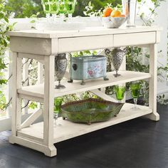 Equally at home behind your sofa or in the entryway, this 2-drawer wood console table is perfect for stacking art books or crafting a colorful vignette.