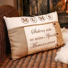 Finished with a warm sandy linen material alongside a cream polyester material featuring a beautiful saying reading' Mums, Side by side or miles apart mums are always close to the heart' printed in a chocolate brown print creating a memorable gift for that special lady in your life complimented by three cotton flower decorations with a button to the centre. A neutral cushion that can be used in almost any room in the house. Gift for Her.