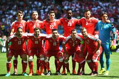 Switzerland players line up for the team photos prior to the UEFA EURO 2016 round of 16 match between Switzerland and Poland at Stade Geoffroy-Guichard on June 25, 2016 in Saint-Etienne, France.
