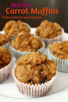 Healthy Carrot Muffins with Raisins and Walnuts - made with Whole Wheat Flour, Greek Yogurt and Maple Syrup for a NO GUILT muffin. Breakfast on the go or the perfect snack.