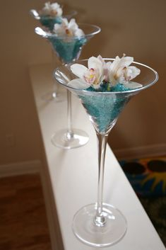 tall martini glass w/vase filler and floral on top