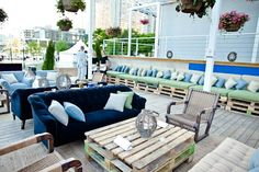 The V.I.P. area of Torontos Power Ball was styled with rustic elements for an English-picnic look. Designers used loading palettes as banqu... Photo: Josh Fee for BizBash