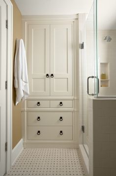 Bathroom storage cabinet - beautiful idea! I also love the frame-less shower and weave tile floor!