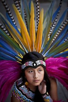 """Aztec dancer. different dances have different meanings. Some dances are offerings to the sun and wind, others to mother earth or ""happiness in the heart."""