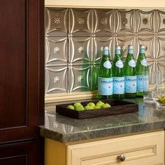Try tin ceiling tiles as kitchen backsplash for texture and creativity
