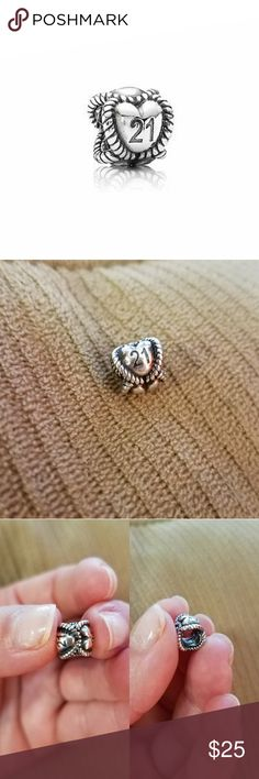 Pandora 21 Charm Celebrate a milestone with this cute charm from Pandora. This charm has been discontinued from Pandora.  Was taken to clean at the Pandora store before listing. Will come in Pandora pouch. Used lightly. Pandora Jewelry