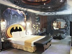 When you think of luxury, you probably picture the Batcave, right? OK, so how about you take away all of the cave aspects, but include all the gizmos of the Batcave, add in a flat-screen TV, and hotel high rolling, and you've got what Taiwan's Eden Motelputting down. Yeah, a Batman-themed hotel room. Sure, themed rooms can be a dime a dozen nowadays, but this Batman room went well above and beyond the call of duty. It has cave-like walls to give you the feeling that you are well below Wayne Manor, but then a cityscape of Gotham above the bed fit for Bruce himself. There looks to be a second bed, too, which appears to be modeled after the Batmobile, so have fun fighting over that with your whoever you've brought along for this bat-cation. Because, seriously, dibs on the Batmobile bed.  The room is also outfitted with enough Batman logos to make you feel like your actually the caped crusader. Can't figure out if the early morning wake up call is a giant Bat ...