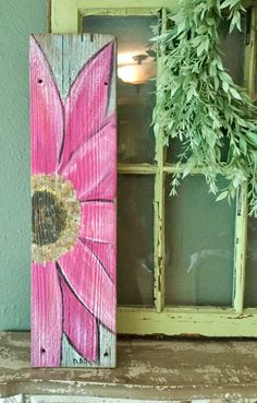Gerber Daisy wall hanging on recycled Barn-board. color pink, height is 21 inches width 5 inches, this is a beautiful Gerber pink Daisy would be gorgeous hanging on the wall. Fence Board Crafts, Old Fence Boards, Diy Fence, Garden Fence Art, Fence Ideas, Garden Ideas, Old Window Projects, Art Projects, Old Window Crafts