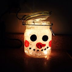 Mason jar snowman! Paint the snowman on the jar and fill it with lights. Super cute winter decoration