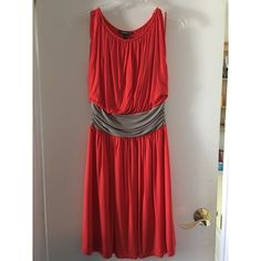 Express Dress Great Spring/Summer Dress.  Very flattering loose fit.  Stretch jersey.  Bright Tangerine orange color with gray sash.  Excellent condition.  Perfect for all those bridal parties, baby showers, weddings that are coming up. Express Dresses