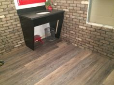 "Real life look of hardwood, but it's a luxury vinyl plank floor. COREtec Plus planks from USFLoors. 100% waterproof floors. Great COREtec Plus installation: 7"" planks showing in Blackstone Oak. #COREtecPlus"