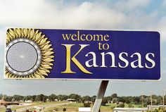 The kids and I walked from the Nebraska sign to the Kansas sign...so the kids said they walked from Nebraske to Kansas!!! LOL