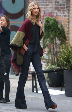 Karlie kloss poncho with flared jeans streetstyle