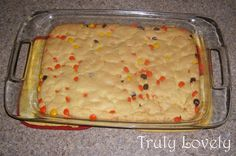 Reese's Pieces Dessert Bars  Ingredients: 1 Cake mix (I use whatever is on sale. This time around it was Betty Crocker, yellow cake... You could also use a chocolate cake mix.) 1/3 cup of oil 2 eggs Candy! The Reece's Pieces are what MAKES this dessert I think, but you could also use M, etc.