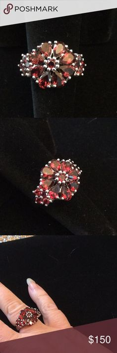 Exquisite Garnet Ring This artistic design of a flower set in .925 silver setting encrusted with genuine garnets.  Stunning design and rich orange red Mozambique garnets.  These are getting harder to find at the estate sales. A beautiful ring for your heirloom collection. Atlanta Estate Jewelry Rings