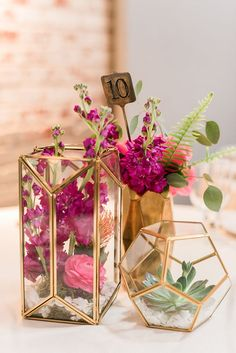 Like gold terrariums with geometric vase, different colour flowers