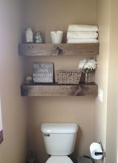 shelves above toilet...not rustic, but like the idea