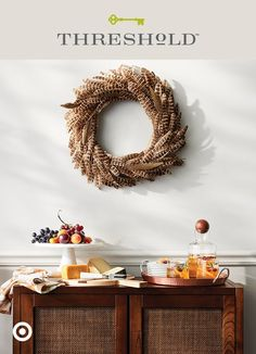 The perfect backdrop to any pre-dinner spread? A mix of raw textures and warm tones, like a hardwood credenza and copper and marble serveware. Add an extra element of allure to your set up—these genuine pheasant plumes give a traditional wreath (and your wall) lots of feathery flair. Then set out a cutting board for cheese, a cake stand with fresh fruit and a tray for drinks, and bring on the dinner guests. Threshold, only at Target.