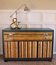 great way to upcycle furniture I have a thing for yard sticks, and containers,and suitcases, and tins, and...