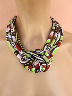 This an interesting necklace made from four tubes sewn stuffed and assembled with a central knot..the colors are stunning that match anything from white