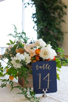 Blue Wedding Flowers Elegant Orange And Navy San Francisco Wedding, DIY wedding centerpiece with flowers, wedding gold foil table numbers - Orange Wedding Centerpieces, Orange Centerpieces, Wedding Flower Arrangements, Flower Centerpieces, Wedding Decorations, Centerpiece Ideas, Wedding Ideas, Rustic Centerpieces, Wedding Crafts