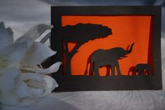 This is a wonderful card, ideal to give to any person who loves elephants, the bush or Africa. The card is made for any occasion, like thank you, happy birthday or thinking of you.   The print is drawn and hand-cut by me.   Inside the card is an orange paper, representing the sunset.