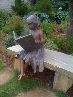 Bronze statue of little girl reading.   Blowing Rock, NC