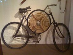custom fire hose bicycle, where the water comes from is anyone's guess