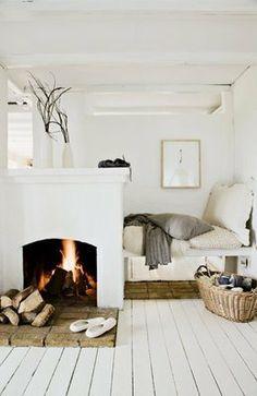 white bedroom cozy fireplace wood warm rustic floor interior design